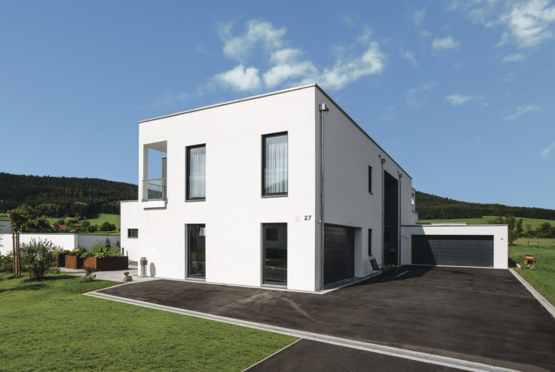 Einfamilienhaus modern mit Flachdach und Garage bauen - Haus Ideen Bauhaus Villa WeberHaus Fertighaus - HausbauDirekt.de