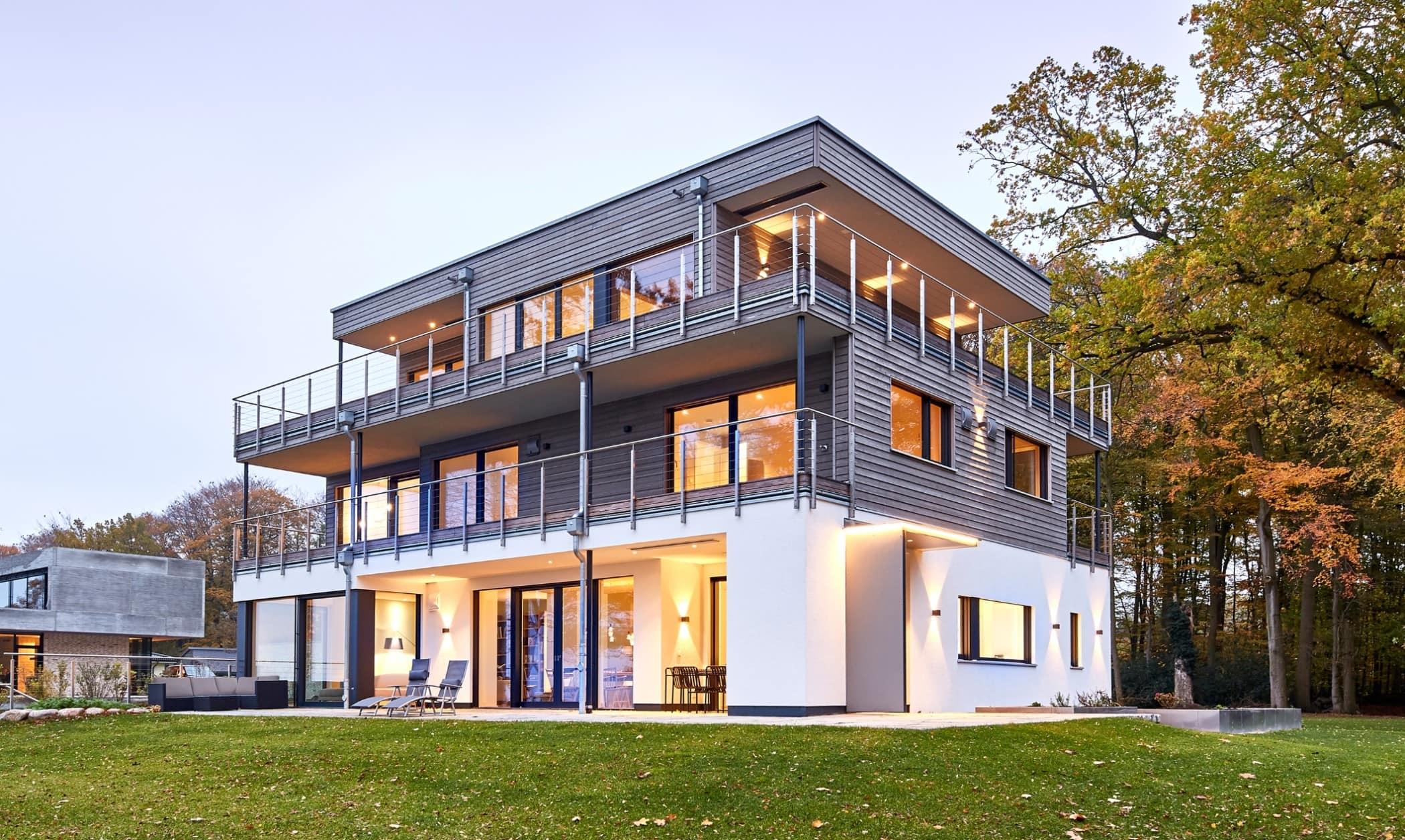 Einfamilienhaus modern mit Flachdach Architektur im Bauhausstil & Holz Putz Fassade - Haus bauen Ideen BAUFRITZ Architektenhaus MEHRBLICK - HausbauDirekt.de