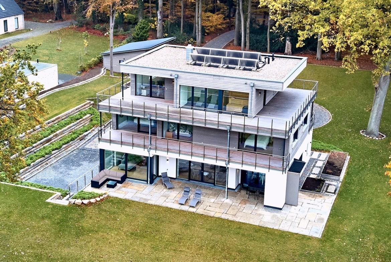 Fertighaus Stadtvilla modern mit Flachdach im Bauhausstil - Haus bauen Ideen BAUFRITZ Architektenhaus MEHRBLICK - HausbauDirekt.de