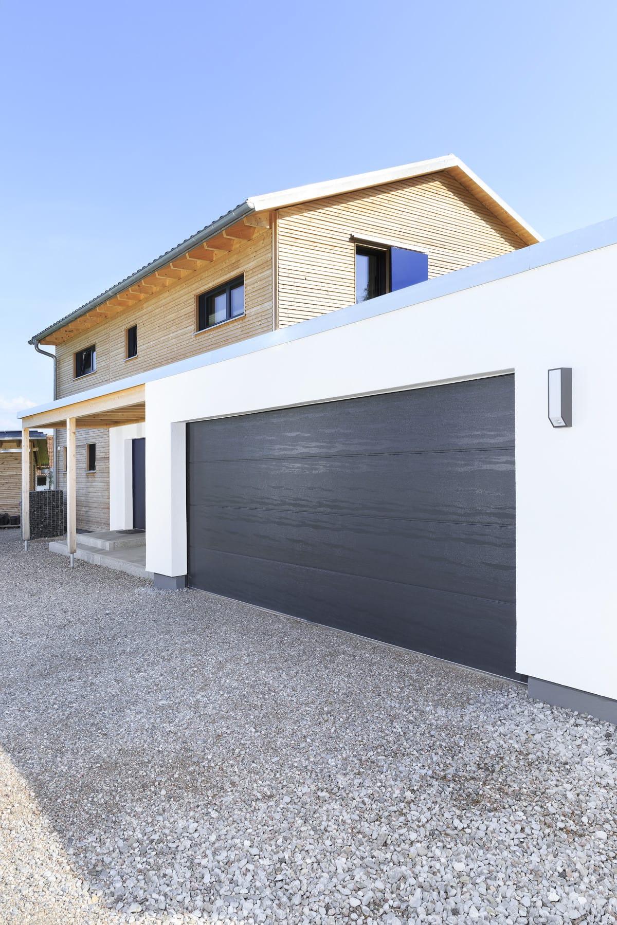 Doppelgarage mit Putz Fassade - Architektur Detail Haus Design Ideen Fertighaus Ökohaus Schneider / Baufritz - HausbauDirekt.de