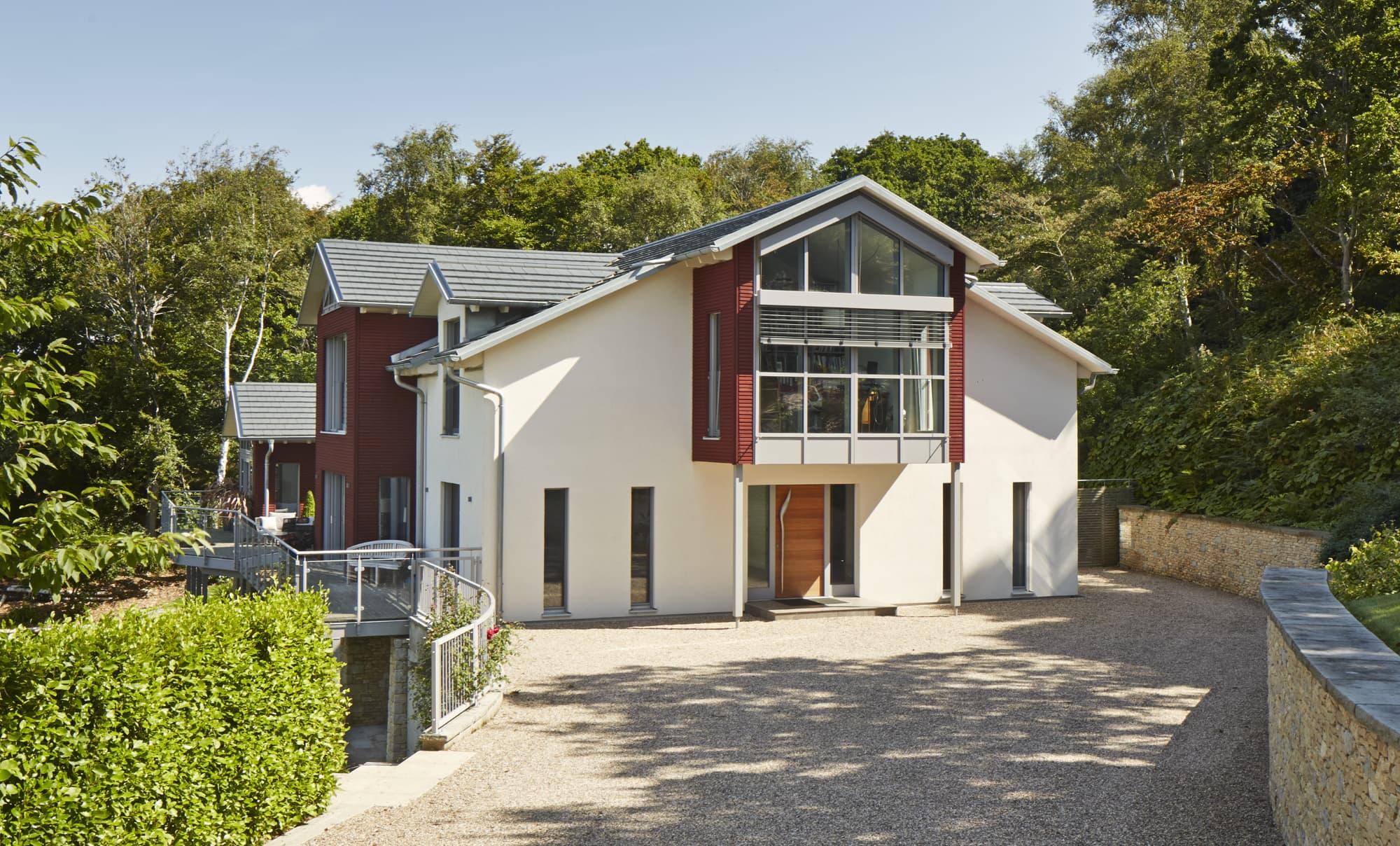 Fertighaus Villa im Landhausstil mit Holz Putz Fassade & Satteldach Architektur - Haus bauen Ideen Baufritz Landhaus FORTESCUE - HausbauDirekt.de
